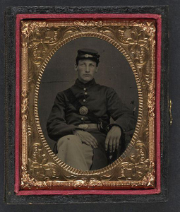[Unidentified soldier in Union frock coat and forage cap with Union Eagle breast plate]