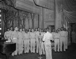 "African American servicemen singing on stage during a recording of the ""Sgt. Gene Autry"" radio program at the municipal auditorium in Birmingham, Alabama."