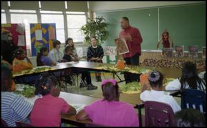 Man with Drawing Speaking to Gates Elementary Classroom San Antonio Chapter of Links Records