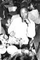 Robert Flowers seated at a table at the Laicos Club in Montgomery, Alabama, during a performance by the Sheiks.