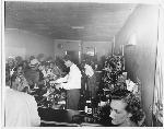 Patrons seated and standing at bar at Slim Jenkins nightclub Oakland, California
