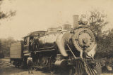 Men standing in front of an engine, probably a Southern Railway train.