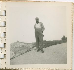 Digital image of a Taylor family man by a lighthouse on Martha's Vineyard