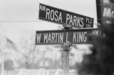 Street signs at the intersection of Northwest Rosa Parks Plaza and West Martin L. King Highway.