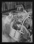 Manpower. Negro bomber plant workers. Final assembly of the pilot's compartment is being made by these Negro workers in a large Eastern aircraft factory. These youths went directly from a war training course to their jobs in this plant. Glenn L. Martin Bomber Plant. Baltimore, Maryland