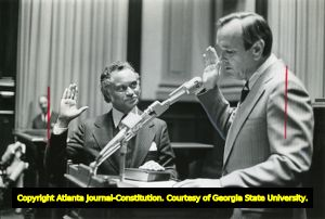 """Horace T. Ward (left) being sworn in as Fulton County Superior Court Judge. Georgia Governor George Busbee administers the oath of office, Atlanta, Georgia, March 1977. Print stamped """"Thu Nov 2 1979."""""""