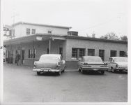 Mississippi State Sovereignty Commission photograph taken from the parking lot of a police officer walking past the entrance of Stanley's Cafe, Winona, Mississippi, 1961 November 1