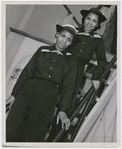 "Thumbnail for SPARS Olivia Hooker, of Columbus, Ohio, and Aileen Anita Cooke, of Los Angeles, California, aboard the dry-land ship ""USS Neversail,"" during their training at the U.S. Coast Guard Training Station, Manhattan Beach"