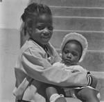 Black child holding sister