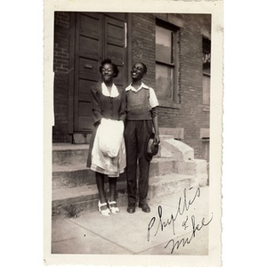 Phyllis and Michael E. Haynes pose in front of a church on Ruggles Street.
