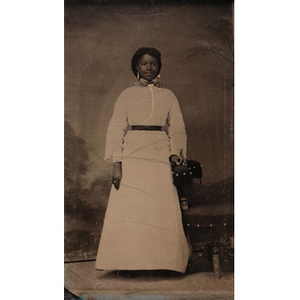 An African-American woman in a white dress.