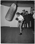 Boxer Henry Armstrong trains with a punching bag, Los Angeles, 1930s