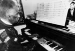 Gerald Wilson playing piano