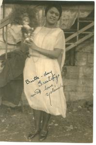 Yolande Du Bois in Fisk University jubilee dress holding doll