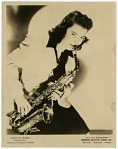 "Rosalind ""Roz"" Cron [playing saxophone] [black-and-white photoprint]"