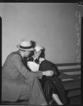 Thumbnail for Ann Forst sits with an unidentified man at the county jail after being charged with operating a prostitution ring, Los Angeles, 1940