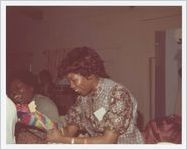 Photograph of women working on crafts and puppets for a puppet show, Athens, Georgia, circa 1975