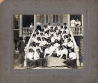 "Women's class sitting on steps with banner ""Esse Quam Videri '11"