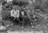 Men on rocks photograph