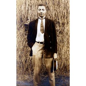 Postcard, man standing in field