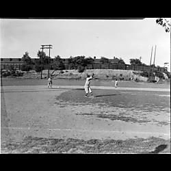 Baseball game at Greenlee Field, fielder catching ball