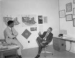 John W. Wade, head of the architecture program at Tuskegee Institute, in his office with an assistant.