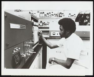 Michael D. Shaw conducting urine analysis at St. Francis Hospital toxicology laboratory