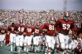Alabama football players leaving the field, probably for halftime, during a game against Wichita State University in Tuscaloosa.