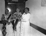 Three members of South Gate Lodge #27 of the Order of the Eastern Star holding floral bouquets