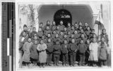 Father Vincent Lebbe with a large group of smiling Chinese boys, China, ca. 1910-1930