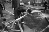 Thumbnail for Man drinking water from a fire hose during the Children's Crusade in Birmingham, Alabama.