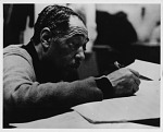 [Duke Ellington composing at the piano during a State Department tour in Pakistan: black-and-white photoprint.]