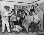 Group singing around piano includes three people in blackface, Seattle Civic Opera-Moonlight Cabaret Minstrels, 1951