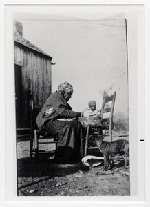 African American Woman, Brown Lylie, Sitting in Front of Basket