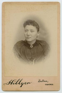 Photograph of a Dark Clothed Woman