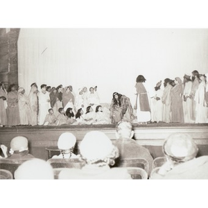 Group of children perform on stage.
