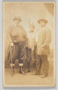 Photographic postcard of three unidentified women