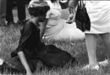 A woman sitting in the grass outside Martin Luther King, Jr. funeral.