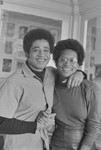 George Jackson with arm around and holding hand of black woman, San Quentin Prison