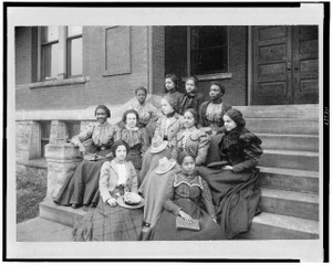 [Junior normal class of Fisk University, Nashville, Tennessee, seated on steps outside of building]