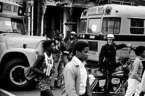 Bused black schoolchildren arrive with police escort at South Boston High School during court-ordered desegregation crisis, South Boston