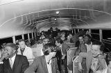 """People on a bus at the """"Stars for Freedom"""" rally at the City of St. Jude in Montgomery, Alabama, the night before the end of the Selma to Montgomery March."""