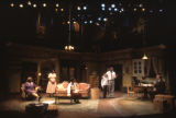 Actors and actresses in a scene from the play A raisin in the sun