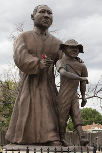 Photo of the statue of the civil-rights pioneer at the Dr. Martin Luther King Jr. Cultural Center and Museum in Pueblo, Colorado, taken in September 2015, one year before the museum was closed and its artifacts placed in storage. King stands besides a young Emmett Till, a young Mississippi man whose murder by whites in 1955 helped spur the civil-rights movement