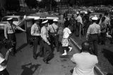 Police officers arresting young civil rights demonstrators during the Children's Crusade in Birmingham, Alabama.