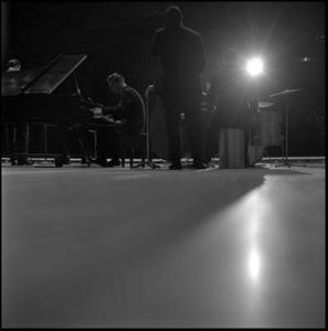 [Dave Brubeck Quartet performing, from back]