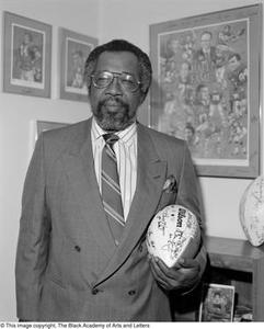 Abner Haynes posing with football memorabilia #2 Dallas/Fort Worth Black Living Legends Dallas/Fort Worth Black Living Legends, 1991