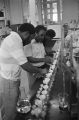 Men performing agricultural experiments in a laboratory at Tuskegee Institute in Tuskegee, Alabama.