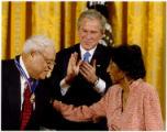 Benjamin and Frances Hooks with President Bush during medal presentation
