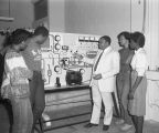 Students looking at equipment in a science classroom at Tuskegee Institute in Tuskegee, Alabama.